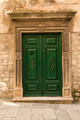 Beautiful old green wooden in historic Sibenik, Croatia