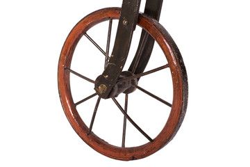 Close up on wheel of a historical bicycle on a white background
