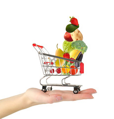 Shopping trolley on woman hand, isolated on white