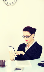 Business woman using a tablet.