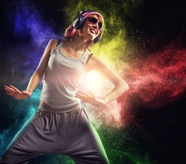Stylish teenage girl with headphones dancing