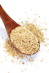 Natural sesame seeds on a white