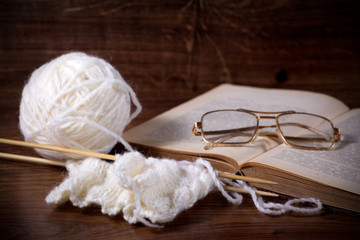 white clews with book and glasses