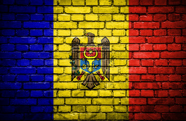 Brick wall with painted flag of Moldavia