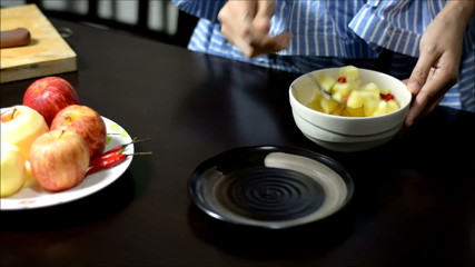 time lapse hands cooking  fruit salad