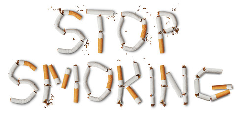 Text ''stop smoking'' made from broken cigarettes