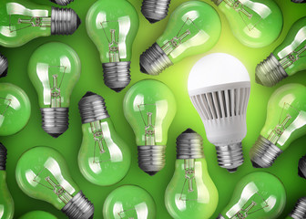 Concept for big idea. Glowing LED bulb on green background