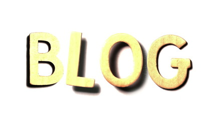 The word blog landing on white surface