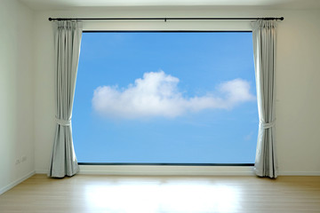Empty room and curtain open to sky