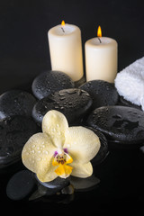 Beautiful spa set of yellow orchid (phalaenopsis), zen stones wi