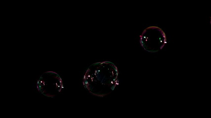 Bubbles floating on black background