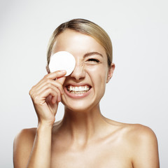 laughing woman removing makeup