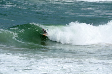 Surfer on green Ocean Wave in the Tube