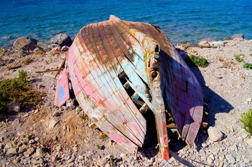 Destroyed boat on coast