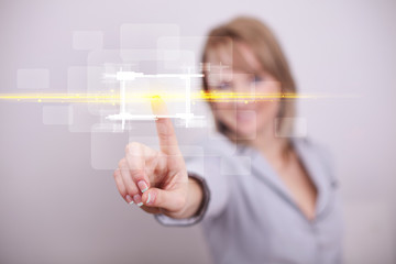 Young tech lady touching button with orange light beams concept