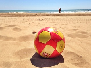 Spanish Soccer and Football Ball on Beach