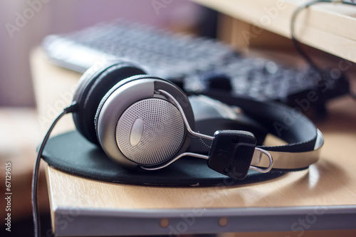 Stereo headphones on the keyboard of a computer - 67129615