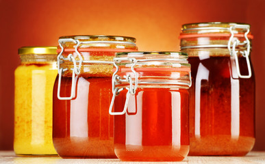 Composition with jars of honey