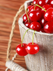 Fresh cherries in a wood bucket