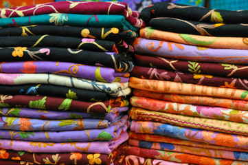 Pile of traditional colorful Arabic scarves