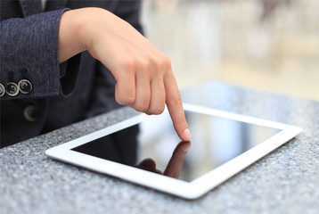 Woman hand touching screen on modern digital tablet