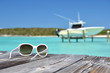 Sunglasses on the wooden jetty. Exuma, Bahamas