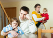 Young family of four having quarrel