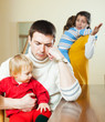 Family of four having quarrel