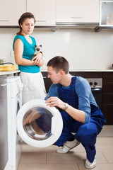 Worker repairing washing machine