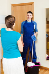 Woman meeting smiling cleaner