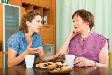 Pensioner having having discussion with daughter