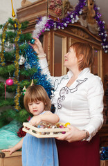 grandmother and child preparing for  Christmas