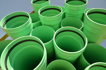 Stacks of green PVC water pipes