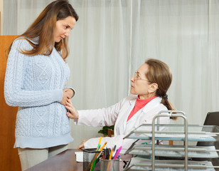 Doctor with young female patient