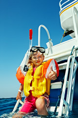 Happy child on yacht.