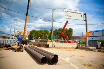 Construction site, construction cranes and pipe