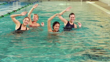 Fit women doing aqua aerobics in the pool