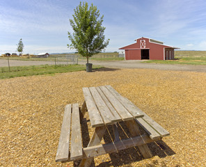The country barn and picnic bench.