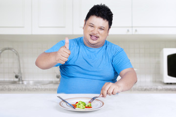 Man eats organic vegetable 1
