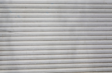dirty old roller shutter for backgrounds