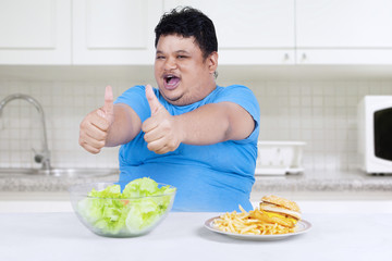Man showing healthy and unhealthy food 2