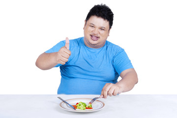 Man try to diet by eating salad 1