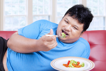 Man try to diet by eating vegetable 1