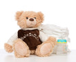 Child stack of diapers and baby feeding bottle with water