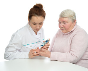 Doctor woman measuring glucose level blood test with glucometer