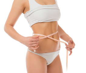 Dietting weight loss concept measuring waist with tape measure