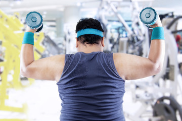 Overweight man doing fitness