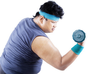 Overweight man exercising with dumbbell 1
