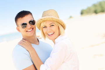 Adult couple spending time at the beach