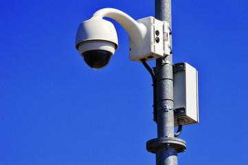 Hi-tech dome type camera over blue sky